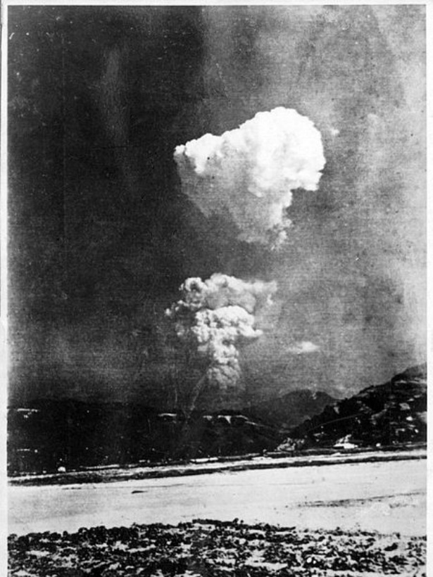Rare Photo of the Mushroom Cloud Over Hiroshima Discovered in a Japanese Elementary School  The picture is a rare glimpse of the bomb's immediate aftermath, showing the distinct two-tiered cloud as it was seen from Kaitaichi, part of present-day Kaita, six miles east of Hiroshima's center. […]  The person who took this photo would have been among the first to look out there and realize that this wasn't just your run-of-the-mill bomb. It wasn't the air raid that the citizens of Hiroshima had been anticipating for months. This was the beginning of a new world. Read more. [Image: Honkawa Elementary School]