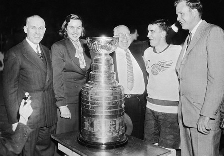 nhlredwings:  Marguerite Norris was featured on NBC Sport's Facebook today. I had no idea who she was. This is awesome. Marguerite Norris (1927 - May 1994) was the first female executive in NHL history. Marguerite Norris was the team president of the Detroit Red Wings of the NHL from 1952 - 1955. She was the first female chief executive in the history of the National Hockey League. She was the first woman to have her name engraved on the Stanley Cup (in 1954 and 1955). The team finished first in all three seasons she was at the helm. She became president of the Red Wings after her father James Norris Sr. died in 1952. She was the sister of James D. Norris and Bruce Norris. Her father and two brothers are all members of the Hockey Hall of Fame. The Norris Trophy awarded to the NHL's Best Defenceman is named after her father. Marguerite resigned as President of the Detroit Red Wings in 1955, and her brother Bruce took over running the team.