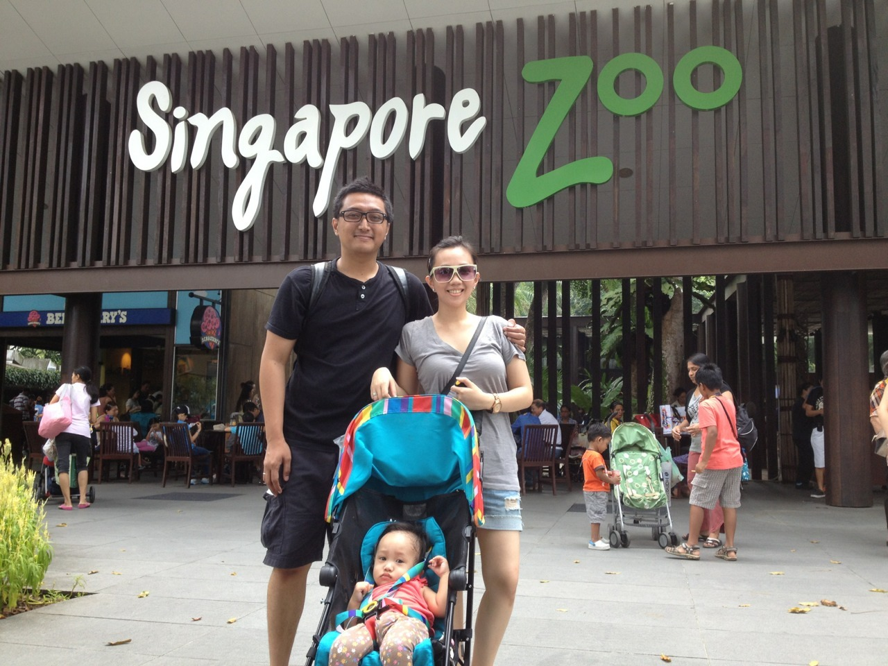 Singapore Trip 2013. Day 2.  We got to the Singapore Zoo a bit late, around 11ish and there's already a long queue to purchase the tickets. Should've bought them online before coming. After 45 minutes of queuing to buy the tickets, we got in. It was a hot sunny day and lots of people, too. Passing by some birds, pink flamingos, and orang utans, we went straight to elephants. You've recognized elephants from books and dolls but now they're infront of you, doing mud bath and swimming. After the elephants, we're looking for KFC to grab lunch. When we got there, KFC was jam packed with parents and kids and there's a pretty large water playground like Playparq infront of KFC. Since we didn't bring your swimming suit, we bought at the store and you played for half an hour or so. On our way out we got to see some giraffes, rhinos, even heard roaring lions & tigers, but you went asleep somewhere after giraffes. Finally we decided to go back to the hotel cos the sun was too hot and we're exhausted. Back in hotel, cleaned ourselves up and head to ION Orchard for dinner.