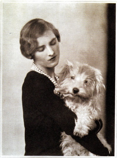 vintagebinger:  Lady Plunket with her Sealyham Chuddy, photographed for Vogue by Edmund Harrington in 1929. Plunket, the illegitimate child of the 7th Marquess of Londonderry and silent film star Fannie Ward, married Lord Plunket in 1922. They were international jet-setters who rubbed shoulders with the likes of Douglas Fairbanks, Jr. The couple perished in a private plane crash in 1938 while traveling from Los Angeles to William Randolph Hearst's ranch in California. Photo from Dogs In Vogue by Judith Watt.
