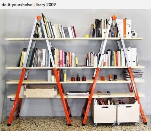 bookshelfporn:  DIY Ladder Bookshelves To get this look, all you need are two ladders and some wood planks. Paint the ladders and the wood if you want, then slide the wood planks through the ladders so they are resting on the ladder steps.