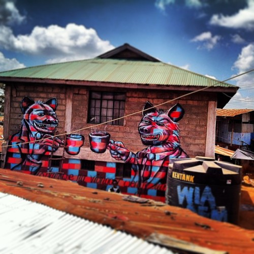 Kibera Walls for Peace youth arts project: Nairobi, Kenya. Resisting the desires of corrupt leaders (hyenas) is key to cultivating peace.