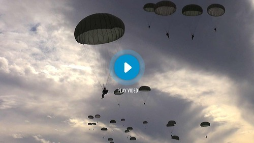 We got to ride along with the Army's 82nd Airborne Division during training — and now you can too!  Watch 240 paratroopers hurl themselves into the sky.