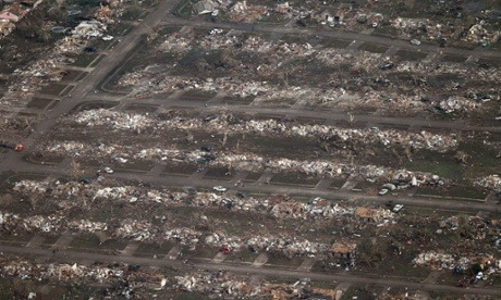 Oklahoma tornado: 91 feared dead - live updates via the Guardian [This aerial photo shows the remains of homes hit by a massive tornado in Moore, Oklahoma, on Monday. Photograph: Steve Gooch/AP]