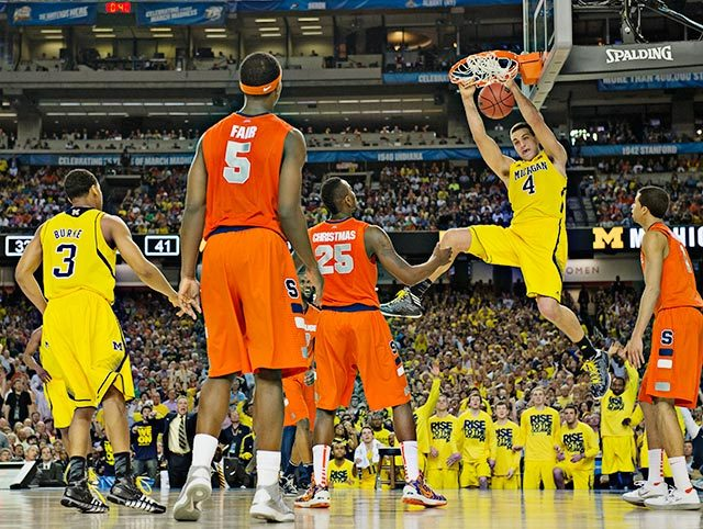 Michigan freshman Mitch McGary slams home an easy bucket during the Wolverines victory over Syracuse on Saturday. Michigan will be going for its first national title since 1989 when it takes on Louisville Monday night. (John W. McDonough/SI) GALLERY: Best Shots of the 2013 Final Four