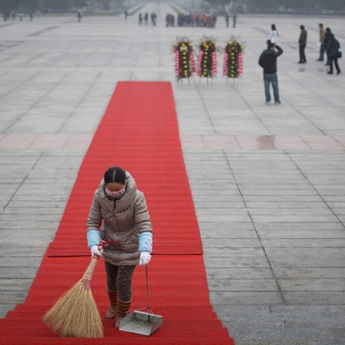A cleaner sweeps up before a flower placing ceremony at the Mao Zedong memorial in Mao's Home Town of Shaoshan, China, January 12, 2013. (John Lehmann/The Globe and Mail) follow @johnlehmann for more images from his trip to China. #china #mao #photojournalism
