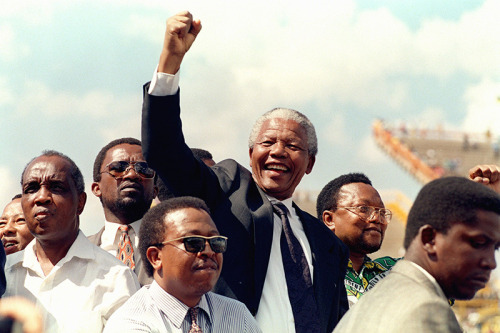 May 9, 1994: Nelson Mandela is Elected President of South Africa On this day in 1994, South Africa's parliament elected Nelson Mandela as the country's next president. The next day, Mandela was inaugurated, becoming the nation's first black president and a symbol of change in the post-apartheid era.  Nelson Mandela's election was even more triumphant, as he had spent 27 years in prison for his involvement in the anti-apartheid and anti-colonial movement. While in prison, Mandela had been confined to a small cell with the floor his bed, a bucket for a toilet, and he was forced to do hard labor in a quarry. He was allowed one visitor a year for 30 minutes. He could write and receive one letter every six months. Through his intelligence, charm and dignified defiance, Nelson Mandela eventually bent even the most brutal prison officials to his will, assumed leadership over his jailed comrades and became the master of his own prison. He emerged from it the mature leader who would fight and win the great political battles that would create a new democratic South Africa. Learn more about Nelson Mandela's time in prison and his early years as a revolutionary with FRONTLINE's The Long Walk of Nelson Mandela site. Photo: South African National Congress (ANC) President Nelson Mandela gives a clenched fist to supporters upon his arrival for his first election rally on March 15, 1994 (WALTER DHLADHLA/AFP/Getty Images).