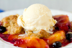 Peach and blueberry crumble topped with vanilla ice cream by Brown Eyed Baker on Flickr.