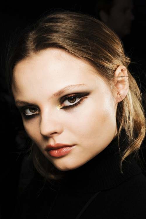 Magdalena Frackowiak backstage at DSquared2, fall 2011