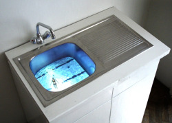 endthymes:  maria anwander, 'untitled' 2005; installation, sink/video—a bird's eye view of a person swimming is projected up from under the sink; the film is looped without a visible transition