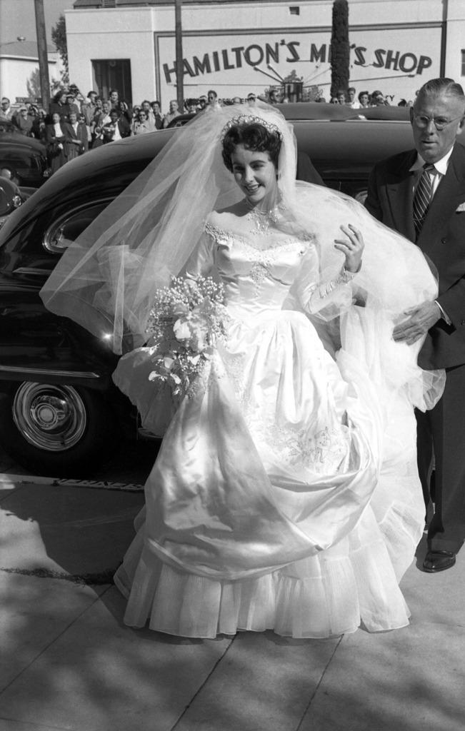 "bohemea:  Elizabeth Taylor at 18 on her wedding day to Conrad ""Nicky"" Hilton, 1950"