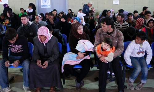 Syrian families wait their turn to register at the UNHCR center in the northern city of Tripoli, Lebanon. The UN has announced today that the number of Syrian refugees fleeing the conflict has reached 1 million. Photograph: Bilal Hussein/AP