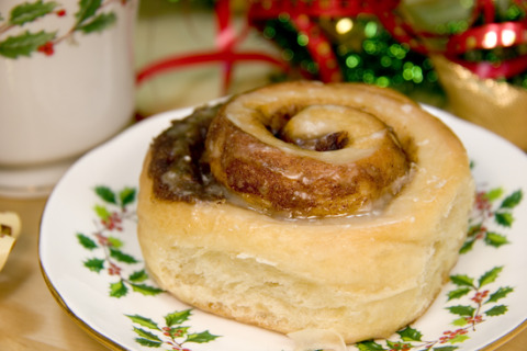 Vegan Cinnamon Eggnog Rolls Dough: 1 cup Vegan Eggnog, warm like a hot bath 1 tbsp Quick Rise Yeast 1/2 cup Canola Oil 3 tbsp Agave Nectar 1 tsp Apple Cider Vinegar 1/2 tsp Salt 3 – 3 1/2 cups All-Purpose Flour Filling: 1/3 cup Margarine 3/4 cup Brown Sugar 2 tsp Cinnamon 1/2 tsp Nutmeg Icing: 1 cup Icing Sugar 1/4 cup Vegan Eggnog 1/2 tsp Eggnog Extract (optional) Prepare a 9 x 13 inch baking pan. I used parchment paper. Place all the filling ingredients in a bowl and stir together until thoroughly combined. In a large bowl, dissolve the yeast in the warm eggnog. Stir in oil, agave, vinegar, and salt. Add 3 cups of flour, one cup at a time, stirring until well incorporated. When dough becomes too stiff to stir, finish incorporating flour by kneading it in. Turn dough out onto a floured surface and knead until smooth and elastic, adding more flour if necessary (takes about 5 minutes). Immediately roll out the dough into a rectangle (approximately 21 x 16 inches). Spread the filling over the dough, roll up, and cut into 12 rolls. Place rolls in the prepared baking pan and let rise for 45 – 60 minutes, until rolls have doubled in size. Pre-heat oven to 350°F. When rolls have finished rising, bake for 20-25 minutes, until golden brown. Allow to cool for 15 minutes before icing and serving. To make the icing: sift the sugar to remove lumps, then stir all the icing ingredients together until smooth. Makes 12 rolls.
