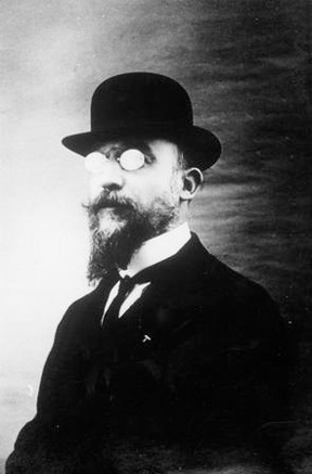 "Erik Satie (May 17, 1866 - 1925) was a French composer who ranks among the oddest figures in late 19th C./early 20th C. music. He preferred to be called 'gymnopedist' or 'phonometrograph' rather than 'composer', and his pieces - often whimsically titled bagatelles for piano - have a hypnotic and addictive effect on the listener. They sound simple but are actually hard to perform properly (not as pretty little ditties, but as complex and minute variations on a minimalist theme - Vexations for instance calls for 840 repetitions). Sequences such Gymnopédies and Gnossiennes foreshadow later ambient music, as do the later pieces that Satie himself dubbed 'furniture music'…  Satie was friends with the Dadaists and Surrealists and collaborated on their film and publishing ventures, often writing pieces that were easily as odd as his compositions. Satie clearly felt out of step with the mainstream of his age: ""I came into the world very young, in an age that was very old…"" Above: Satie pioneers the use of mirrorshades… Below: A performance of the 3 Gymnopédies"