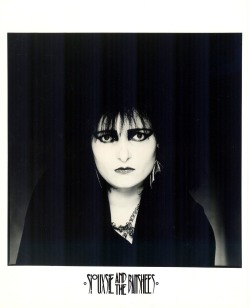 gorgonetta:  [B/w promo photo of Siouxsie wearing bat-wing earrings]