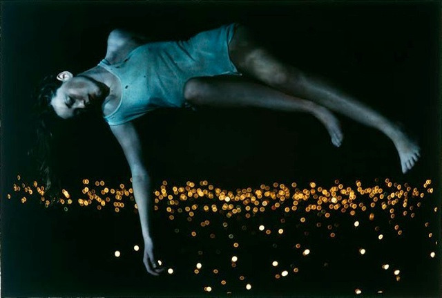 Floating Girl serie by Bill Henson Melbourne born photographer Bill Henson is a light sculptor playing in the darkness inspired in the tradition of the great European painters. His powerful and edgy photographs approach both the painterly and the cinematic, bringing together the formal and classical with the gritty, casual dramas of the everyday. Creating  confronting, beautiful and, unforgettable images, he captures a universal essence with a mysterious darkness.