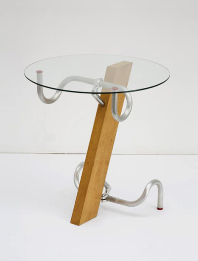 userdeck:  Handlebar table.  DIY, inspiration — if you can get your hands on some old bike handlebars!  More uses for old bicycles and bike parts here.