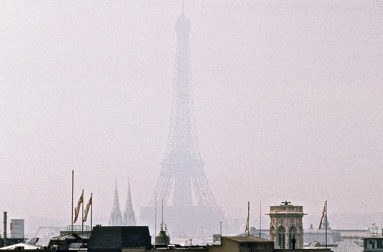 Eiffel Tower in fog. Photographed by Daniel Sorine