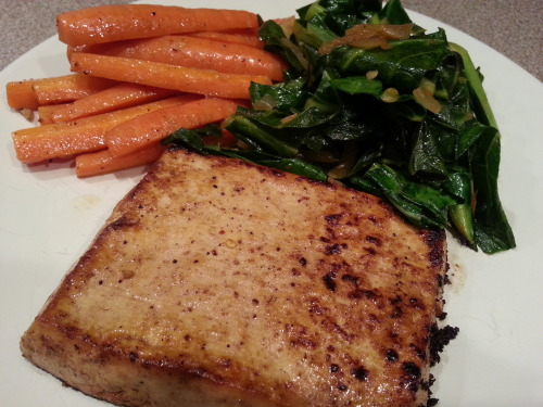 Baked and Seared Tofu Steaks with Sauteed Collards and Carrots. Squeeze a block of firm tofu and slice in half laterally (so it's long and skinny, not stout). Marinate with 1 tbls melted margerine, 2 tsp dijon mustard, 1 tbls white wine vinegar, and a dash of soy sauce. Brush over tofu and put in a baking dish. Bake at 375 for 40 minutes, maybe even 50 if you want it even firmer.  Dice half an onion and stir it over a bit of oil (or water or veggie broth) in a large skillet. Add 4.5 cups (dry and chopped) collards and fold them in until they cook down a bit. Add 1 tsp red pepper flake, 1.5 tbls soy sauce and 2 tsp garlic and let it cook into the greens for a few minutes. Remove from heat.  Slice about 5 or 6 carrots julienne style and saute with oil, a few dashes of lime juice, white wine, and a tiny dash of nutmeg. Remove from heat. Remove tofu from oven and sear with over med/high heat in a very slightly oiled (hardly any if possible) nonstick skillet. Sear for 2 minutes on each side.  Serve and enjoy!