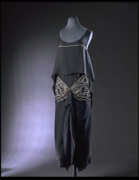 Drecoll | c. 1926 What I imagine Jordan Baker wearing.  The sleeveless design and low, scooped neck would have allowed the wearer to remain cool during even the most energetic dances of the 1920s. And as she danced, the drifting tunic top and the central drapery of the skirt would have flowed with her.
