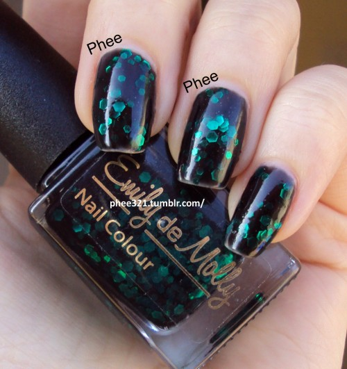phee321:  Emily de Molly Black Forest, 3 coats plus top coat This is a perfect black jelly with forest green glitter.  I feel the squishy layers and the green glitter are so complex, it makes the polish look black with a deep green glow.  I honestly had people stopping me to look at my nails (cashiers, friends, coworkers!).  It applied well - I apologize to the polish and to EdM for the embarrasing tip shrinkage, that is completely my fault!  xo Phee