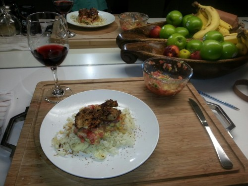 Saturday night dinner for one. Red wine from Matua nz. Peri peri chicken thigh, spicy salsa, ground golden flaxseed, and a bed of cauliflower rice. Omnom.