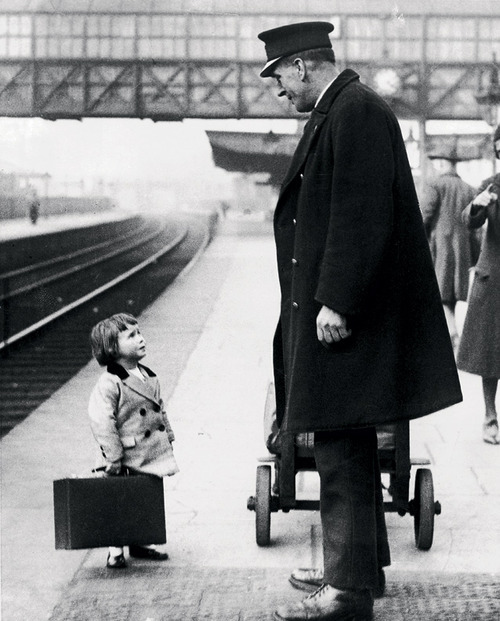 collectivehistory:  A young passenger asks a station attendant for directions. Bristol Railway Station, England, 1936, by George W. Hales