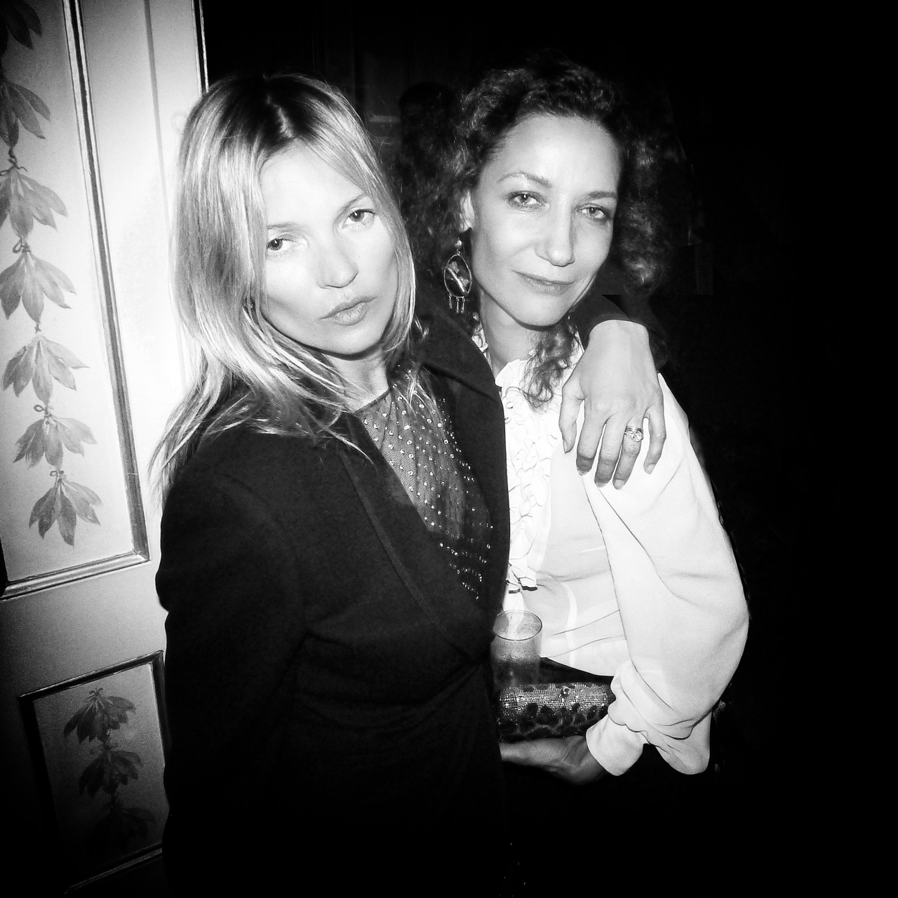Kate Moss & Marpessa Hennink just few seconds before the famous kiss shot by me at Carine Roitfeld's party in Paris | photo credit: German Larkin