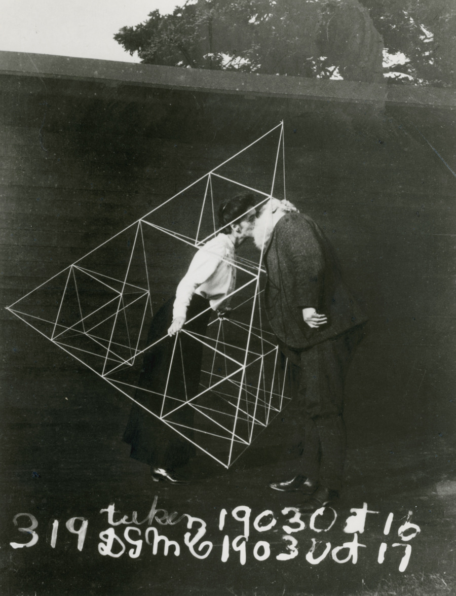kateoplis:  Alexander Graham Bell and Mabel kissing within a tetrahedral kite, October 1903. [natgeofound]