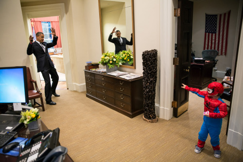 timelightbox:  Pete Souza/The White House President Barack Obama pretends to be caught in Spider-Man's web as he greets the son of a White House staffer in the Outer Oval Office, Oct. 26, 2012. See more never-before-seen photos from the White House here.  I just really love our President.