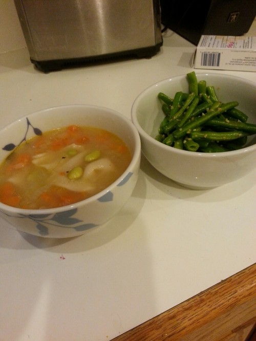 Wonton soup and fresh green beans sauteed with garlic, salt and pepper.