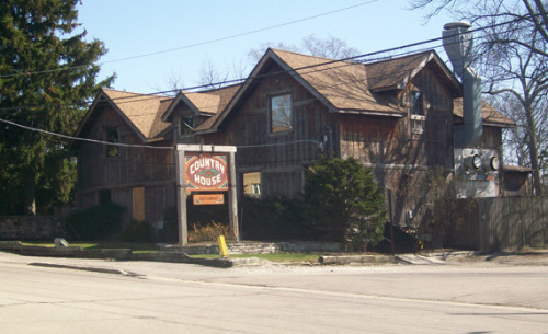 My dad and I went to eat here at this haunted restaurant. Here's the story:  A young woman showed up one day visibly distraught and asked if she could leave her child there for a short while. She had been dating the bartender at the time. When the bartender refused, she took her child and sped off down 55th Street. About a half mile away she struck a tree in an apparent suicide.  My Dad asked our waitress if anything had happened lately and she told us about an incident that happened that wasn't incredibly recent, but was the one that convinced her of the young blonde woman's presence. I found a video. The interior is all rich wood with small tables and saloon chairs. Some antique shadowboxes line the wall you see when you first walk in. Old wine bottles crowned the walls around where we sat. Their website has a collection of things people have experienced there: Here It was 80 degrees when we went there so I wore a sundress in the heat, but when we got in the building, despite how often the door was opening and closing with people coming and going, it was freezing. One would think, well they probably have the air on because it's so hot and there are so many people, but I looked around where I was sitting and saw no vents, and there was no fan above us. It was strange for the cold air to be swirling around on the floor. As for the food, they have the best burgers in Chicago, but I did not get one, I got a steak as per usual, which was terrible, but given the amount of people there and the thickness of it, I could have told you it would be terribly under cooked. Was worth a shot. The french onion soup was amazing though.