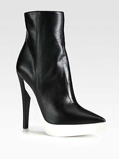 "eBay Search Alert: Stella McCartney Ankle Boots To all the women who braved Blizzard Nemo in New York… we'd like to share these angular ankle boots by Stella McCartney. The best part? It's platformed with a biodegradable rubber sole and faux leather to keep up with the designer's ""be kind to animals"" philosophy. The shoes can be found at Saks Fifth Avenue or you can download the eBay Now app (for the NYC area only) and try to get these shoes delivered to your home in less than an hour. To check out more Stella McCartney booties on eBay, click here.  (Photo: Saks Fifth Avenue. Text: Jauretsi)"