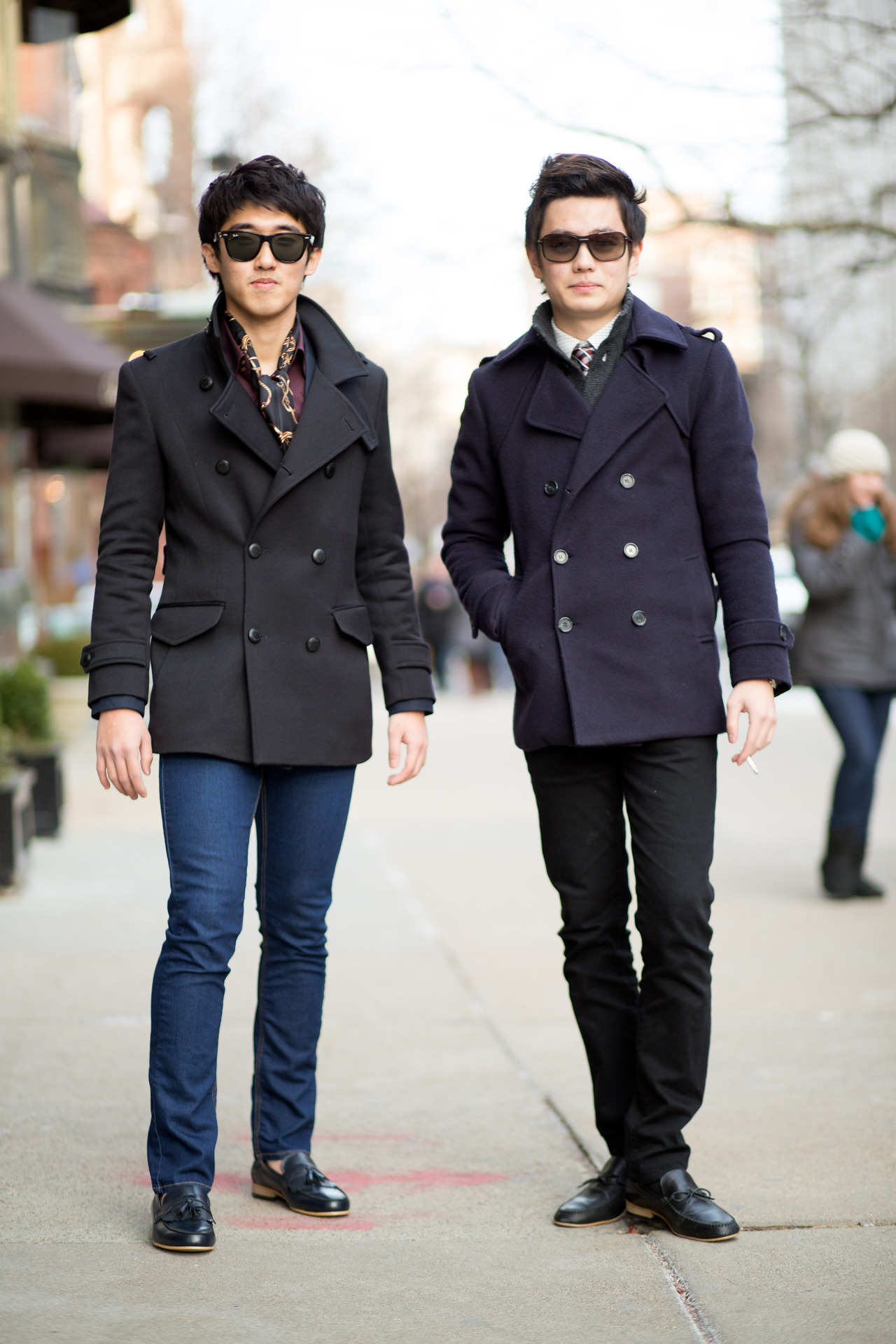 Self Described Style: ModernOccupation: StudentsSpotted at: Newbury St. At a quick glance you would say that these two are dressed very similarly. But upon closer inspection their outfits are perfect mirrors of each other. The black peacoat of the guy on the left is perfectly balanced by the black pants of the guy on the right. And his blue peacoat is perfectly balanced by the other guys blue jeans. It is the yin and yang of peacoat style!