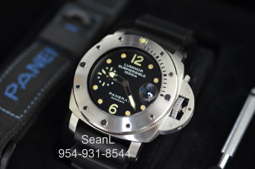 "Panerai 25 G Luminor Submersible ""T"" Dial 44mm Titanium  Please rest assured that if we have the item listed, it\'s in stock and ready for immediate overnight shipping! If you would like additional pictures, please contact us and we will be happy to make available to you as many high resolution images as needed in order to provide you with 100% comfort level with your purchase. Beyond Ebay feedback, we are represented on every major watch forum and we have completed transactions around the globe.  Please feel free to call, email or text us seven days a week as we are here to help.  If you would like to see a watch in person, please make an appointment to visit our private showroom located in the heart of downtown Miami in the historic DuPont Building."