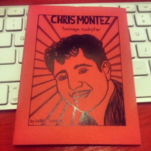 ZINE SPOTLIGHT: Chris Montez, teenage rockstar CREATOR: Gabby Gamboa (who we met at the 2012 S.F. Zine Fest) YEAR: 2011 ORIGIN: Bay Area, California, USA DESCRIPTION: A mini-comic about obscure (but beloved) Latino pop artist Chris Montez. In Gabby's own words:   My father told me a story about how growing up in the 1950s, he and all of the other Mexican American kids in his neighborhood would (falsely) boast about being related to rocker Ritchie Valens. That got me interested in researching the history and obscurities of Chicano rock, and sharing what I find.  When asked in this interview what advice she would give to aspiring comic artists and zinesters, Gabrielle Gamboa suggested the following:  Don't limit yourself by studying only one technique or medium. Practice drawing from observation. Learn about art from before you were born.  Chris Montez isn't presently listed on Gabby's Etsy shop, but contact her if you're interested in purchasing.  Interested in  learning more about some of the other selections in our physical archive? Click here.