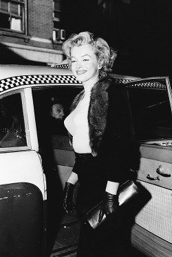 Marilyn Monroe exiting a taxi and making her way to The Actors studio to help promote the film, Baby Doll. New York, 1956