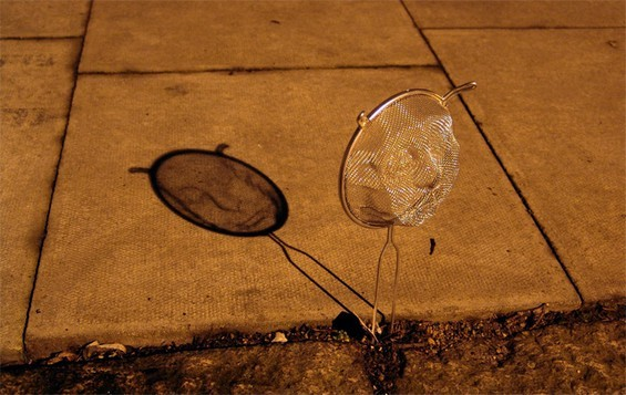 Portraits Using Kitchen Strainers (by Isaac Cordal) Found Here