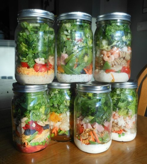 Salad in a jar. A great idea from Mayra Cavazos (via Charles D).  MY NEWEST LUNCH OBSESSION!!!!! Utterly brilliant, people. Not only does SALAD IN A JAR save space in your fridge, it also reduces food waste and gets non-salad eaters (me) to mow down daily. THE ARRANGEMENT From BOTTOM to TOP: Dressing Shredded carrots Cherry tomatoes Sunflower seeds Hard boiled eggs Baby spinach DIRECTIONS 1) Arrange ingredients in a large mason jar 2) Store in fridge for up to a week 3) When ready to eat: shake jar, place on a plate, and eat! You can make any arrangement you want… you can add red onion, cucumbers, radishes or peppers.Always remember to put the dressing at the bottom and the lettuce at the top—a MUST. ****NOTE**** If your making a few salads at a time for the week, you MUST remember to vacuum seal the Mason Jars. (Mason jars can be bought at Wal-mart, and various grocery stores) They must be vacuum sealed to remain fresh and crisp :) Here are two different ways to vacuum seal a mason jar :D http://www.youtube.com/watch?v=fhb1gfVSB9Y Non Foodsaver vacuum seal :) http://www.youtube.com/watch?v=NMDfyRjfBbc (via Facebook)