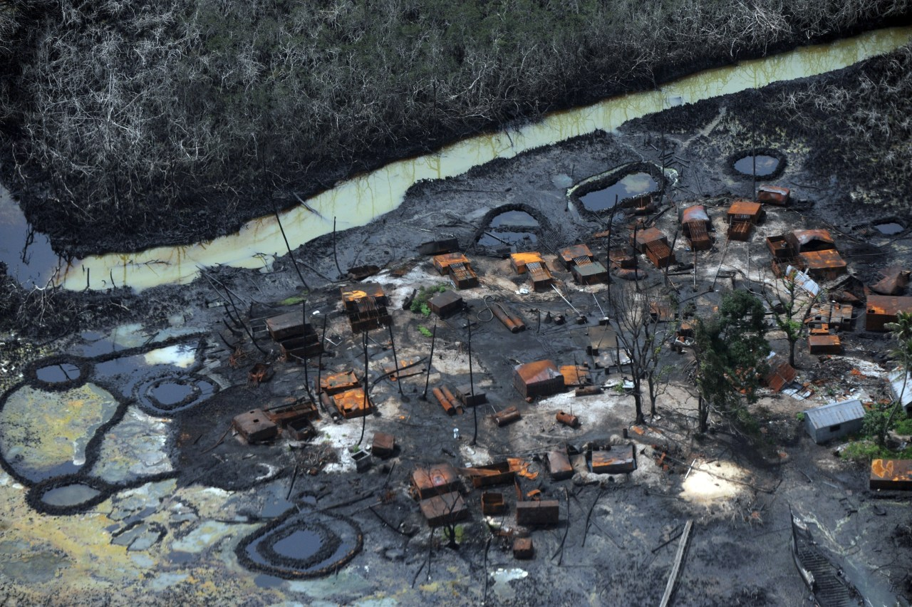 nationalpostphotos:  A picture taken on March 22, 2013 shows an illegal oil refinery destroyed by Joint Task Force at Nembe Creek in the Niger Delta on March 22, 2013.  Shell Petroleum Development Company of Nigeria (SPDC) on April 2, 2013 said it would temporarily shut down production the Nembe Creek Truck Line (NCTL) to remove a number of bunkering points on pipelines vandalised by oil thieves in the region. PIUS UTOMI EKPEI/AFP/Getty Images Click the photo to see more photos.