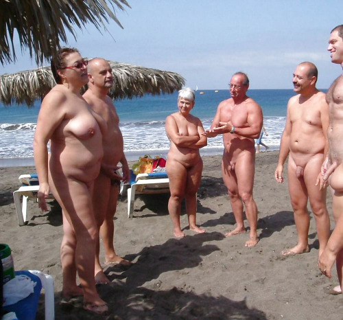 mixedgendernudity:  Naked gathering at the beach  Lets all call Jenny Craig tonight.