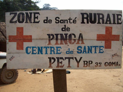 "Photo: The sign outside the health center in Pinga, where armed conflict has made provision of care difficult. DRC 2013 © MSF DRC: Thousands Flee Violence in Pinga, North Kivu Thousands of people have fled the town of Pinga in recent days amid a new wave of armed conflict in the Democratic Republic of Congo (DRC)'s North Kivu Province, making it very difficult to ensure that they receive essential medical care. ""Civilians are routinely exposed to this violence—this is the eighth time Pinga has changed hands since 2012,"" said Jan Peter Stellema, MSF's operations manager in Goma. ""A number of patients had to be transferred for emergency surgery to Goma, among them a 70-year-old woman shot in the arm."""