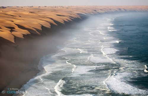 landscapelifescape:  This is the fantastic place where the Namib Desert meets the sea. Namibia Harmony of Nature by Roberto Sysa Moiola