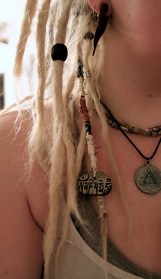 dreadheaven:  Heres my newest addition to my dreads :)  this is probably one of my favorite mantras, Om mani padme hum, reminding us to have compassion for others and all living things including the earth we walk on :)