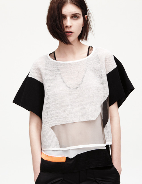 SHEER GEOMETRY Introducing the Transparent Grid Top.