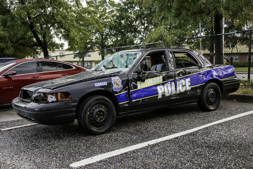 "So this ""Police Car"" was left near Pigtown all bashed up. People were saying some kids stole it and dumped it. Turns out the real story is it was used in a music video where they bash it up and then for some reason just left it behind after the..."