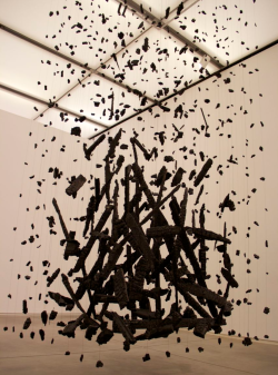 momatalks:  Suspended sculpture. Gotta love this use of space!  pikeys:  Hanging Fire, 1999 by Cornelia Parker