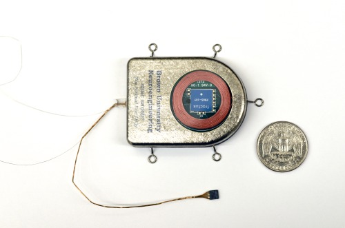 "Wireless, implanted sensor broadens range of brain research A compact, self-contained sensor recorded and transmitted brain activity data wirelessly for more than a year in early stage animal tests, according to a study funded by the National Institutes of Health. In addition to allowing for more natural studies of brain activity in moving subjects, this implantable device represents a potential major step toward cord-free control of advanced prosthetics that move with the power of thought. The report is in the April 2013 issue of the Journal of Neural Engineering. ""For people who have sustained paralysis or limb amputation, rehabilitation can be slow and frustrating because they have to learn a new way of doing things that the rest of us do without actively thinking about it,"" said Grace Peng, Ph.D., who oversees the Rehabilitation Engineering Program of the National Institute of Biomedical Imaging and Bioengineering (NIBIB), part of NIH. ""Brain-computer interfaces harness existing brain circuitry, which may offer a more intuitive rehab experience, and ultimately, a better quality of life for people who have already faced serious challenges."" Recent advances in brain-computer interfaces (BCI) have shown that it is possible for a person to control a robotic arm through implanted brain sensors linked to powerful external computers. However, such devices have relied on wired connections, which pose infection risks and restrict movement, or were wireless but had very limited computing power. Building on this line of research, David Borton, Ph.D., and Ming Yin, Ph.D., of Brown University, Providence, R.I., and colleagues surmounted several major barriers in developing their sensor. To be fully implantable within the brain, the device needed to be very small and completely sealed off to protect the delicate machinery inside the device and the even more delicate tissue surrounding it. At the same time, it had to be powerful enough to convert the brain's subtle electrical activity into digital signals that could be used by a computer, and then boost those signals to a level that could be detected by a wireless receiver located some distance outside the body. Like all cordless machines, the device had to be rechargeable, but in the case of an implanted brain sensor, recharging must also be done wirelessly. The researchers consulted with brain surgeons on the shape and size of the sensor, which they built out of titanium, commonly used in joint replacements and other medical implants. They also fitted the device with a window made of sapphire, which electromagnetic signals pass through more easily than other materials, to assist with wireless transmission and inductive charging, a method of recharging also used in electronic toothbrushes. Inside, the device was densely packed with the electronics specifically designed to function on low power to reduce the amount of heat generated by the device and to extend the time it could work on battery power. Testing the device in animal models — two pigs and two rhesus macaques — the researchers were able to receive and record data from the implanted sensors in real time over a broadband wireless connection. The sensors could transmit signals more than three feet and have continued to perform for over a year with little degradation in quality or performance. The ability to remotely record brain activity data as an animal interacts naturally with its environment may help inform studies on muscle control and the movement-related brain circuits, the researchers say. While testing of the current devices continues, the researchers plan to refine the sensor for better heat management and data transmission, with use in human medical care as the goal. ""Clinical applications may include thought-controlled prostheses for severely neurologically impaired patients, wireless access to motorized wheelchairs or other assistive technologies, and diagnostic monitoring such as in epilepsy, where patients currently are tethered to the bedside during assessment,"" said Borton."
