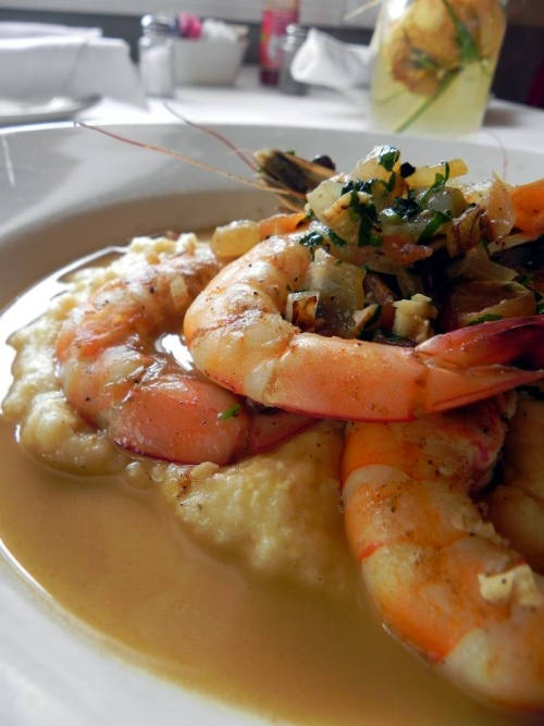 Jumbo Gulf Shrimp & Grits with bacon, tomatoes and a lemon garlic sauce from Fat Hen Grocery