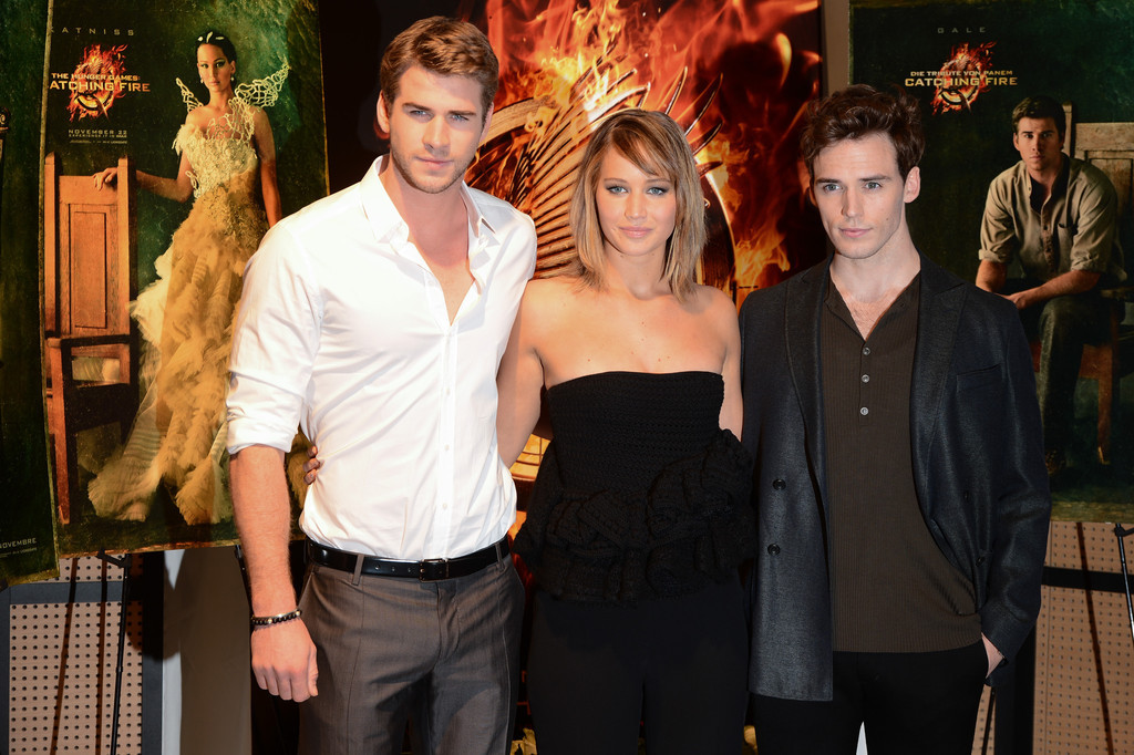 Liam Hemsworth, Jennifer Lawrence and Sam Claflin at The Hunger Games: Catching Fire photocall at the Cannes Film Festival 2013